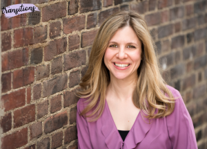 woman in purple top leaning against brick wall